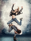 Couple break dancing on wall background