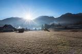 Field in the Bohinj Valley in early winter morning, near Bohinjska Bistrica, Slovenia