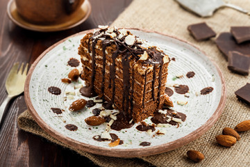 Delicious sweet chocolate Spartak cake on a rustic plate. Haute cuisine dessert with coffee. International food.