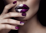 Beautiful girl with art make-up, dark glitter lips design and manicured nails. beauty face. Photos shot in studio. Close up