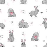 Easter rabbits seamless pattern. Vector background with cute watercolor bunnies.