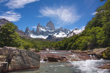 view from the river on a beautiful plumose cloud over Fitz Roy mountain in Los Glaciares National Park in Argentina