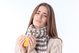 sick girl in  sweater and scarf holding  hot cup of isolated on white background