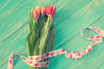 Tulips bouquet with ribbon