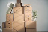 Stack of moving boxes in new house - 136956745