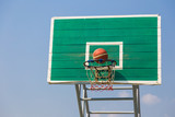 basketball fast moving into the basket at an outdoor field on a