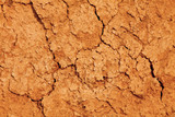 the texture of the clay , the cracks on the surface of the earth , the background is yellow - 136976902