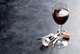 Red wine glass and corkscrew
