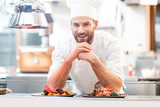 Portrait of chef cook in uniform with prepaired delicious dish at the restaurant kitchen - 136993789