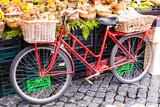 Fruit market with old bike in Campo di fiori in Rome