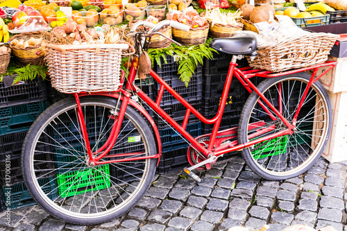 Fotobehang Fiets Fruit market with old bike in Campo di fiori in Rome