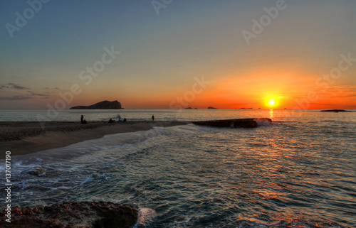 Ibiza beach Compte sunset with bledas islands in horizon