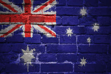 painted national flag of australia on a brick wall