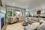 Family room interior features grey linen sectional