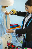 Couturier sews a dress