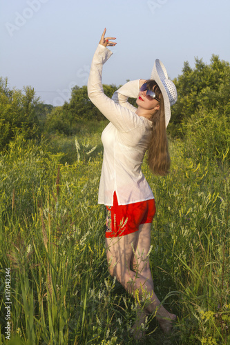 white women in sun hat  posture in field Poster