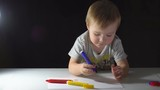 Little Boy Draws With Colored Markers