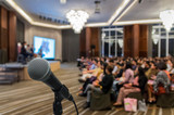 Microphone over the Abstract blurred photo of conference hall or - 137051968