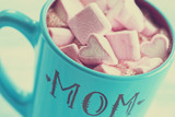 Blue cup of hot chocolate with heart marshmallows for Mom