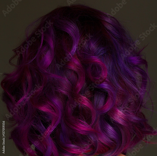 Portrait ofmodel with purple hair over grey background