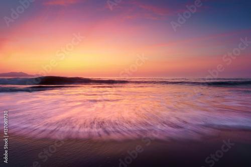 Papiers peints Corail sunset on beach shore