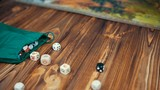 Dices Fall On a Wooden Table From Bag