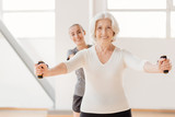 Hard working pleasant woman exercising with a resistance band