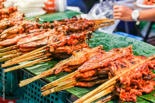 Delicious spicy grilled chicken meat on sticks, Thai food