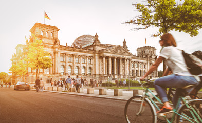 Berlin urban city life with Reichstag at sunset in summer, Germany