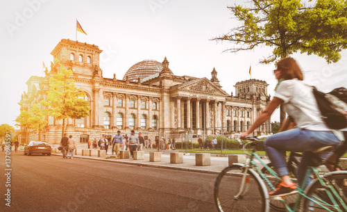 Leinwanddruck Bild Berlin urban city life with Reichstag at sunset in summer, Germany