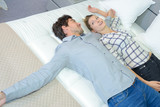 Couple testing new mattress - 137128501
