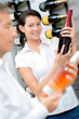Lady holding bottle of champagne