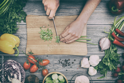 Preparing a meal. Cutting vegetables.