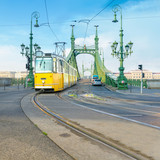 Historic tram on Freedom Bridge in Budapest, Hungary