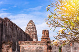 Old ancient pagoda in Lopburi thailand, with Old Exterior Brick Wall Background vintage style grung texture
