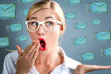Surprised young business woman with emails