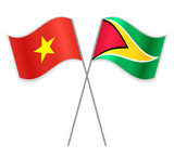 Vietnamese and Guyanese crossed flags. Vietnam combined with Guyana isolated on white. Language learning, international business or travel concept.