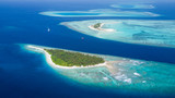 Small tropical island in Maldives atoll - 137181122