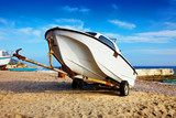 fishing boat on the beach on sunny beautiful day, coast of Black Sea