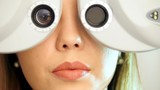 Ophthalmology clinic - woman checks vision by modern equipment, close up