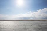 empty brick floor in blue sunny sky
