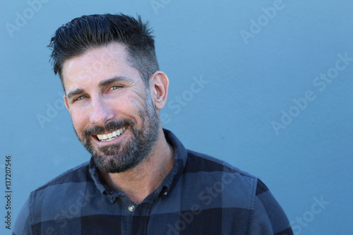 Handsome mature man smiling and laughing Poster