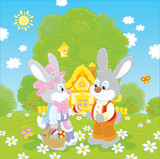 Bunnies with a basket of painted eggs in front of their small house on Easter Sunday