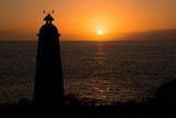 Lighthouse in silhouette at sunset in Tenerife