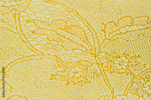 Fototapeta Genuine leather with an abstract ornament, tender color. Closeup on a leather texture. For modern pattern, wallpaper or banner design. With place for your text