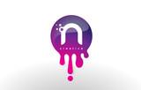 N Letter Splash Logo. Purple Dots and Bubbles Letter Design