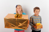 Girl happy with a big present box but her brother has only a small one