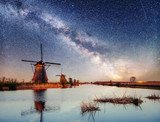 Dutch mill at night. Starry sky. Holland. Netherlands