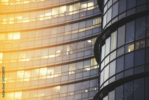 Business building glass with sun flare