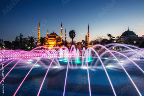 Illuminated Sultan Ahmed Mosque before sunrise Poster
